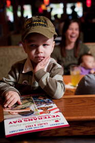 Decisions, decisions, decisions. A child contemplates all of the delicious selections on the Applebee's Veterans Day menu. Applebee's will salute veterans and active duty military with a free meal on Veterans Day.