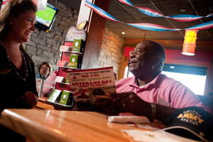 A veteran orders a free meal at Applebee's on Veterans Day, where all veterans and active duty military receive a free Thank You meal.