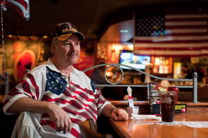 A veteran awaits his free Thank You meal at Applebee's on Veterans Day.