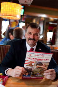 A veteran reviews the menu at Applebee's, where all veterans and active duty military are honored with a free Thank You meal.
