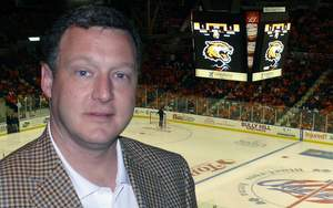 J.M. Allain, President and CEO of Trans-Lux Corp., at RIT homecoming hockey game held at the Blue Cross Arena, home of the Rochester Amerks (part of the NHL's Buffalo Sabres Organization), in Rochester, NY where a new TL Vision LED  Large Screen Video Display was recently installed.