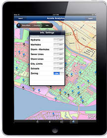 iPad screen showing city map with color-codes to mark zoning districts, and drop pins for activity.