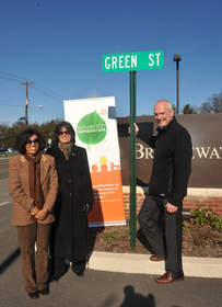 Mayor Patricia Flannery, second left, and local resident Meena Shah, left, join John Murphy of Seventh Generation to celebrate Seventh Generation's Green Your Town Day, Friday, Nov. 18, 2011 in Bridgewater, NJ, with a ceremonial naming of the town's newest thoroughfare, 'Green Street,' at the entrance of its new LEED-designed municipal complex.