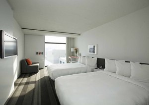 A guest room at TRYP Quebec Hotel PUR