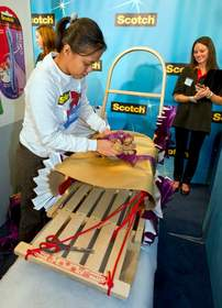 Diana Lemos, a gift wrapper from San Diego, Calif., 'wraps up' a $2,500 cash prize as the first runner-up in the Scotch Brand Most Gifted Wrapper Contest on Friday, December 2, 2011.  Lemos shows off her technique by wrapping a snow sled in Round 2 of the contest.