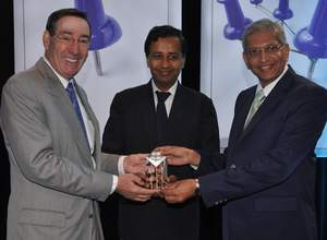 GMAC's Wilson presents TeamMBA Award to SP Jain's Merchant and Gabula