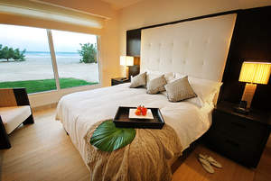 A guest room at Wyndham Grand Playa Blanca