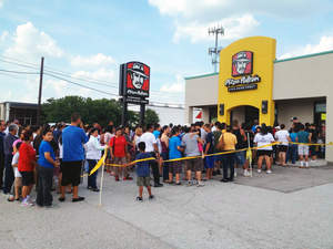 Crowd outside a Pizza Patron store in Dallas