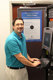 AtNetPlus IT Specialist Rob Walker in Stow data center.