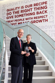 President and CEO of The Wendy's Company, Emil Brolick, proudly accepts the No. 1 Best Adoption-Friendly Workplace in America award from Rita Soronen, president and CEO of the Dave Thomas Foundation for Adoption.