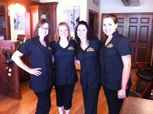 Welcoming new customers to the Roosters MGC in the Belmar Shopping Center are master hair care specialists, from left, Shannon Cook, Jolene Wagner, Richelle Miller and Chelsea Thorp.