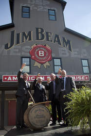 Seventh Generation Jim Beam Master Distiller Frederick 'Fred' Booker Noe III, right, toasts a glass of Jim Beam(R) Bourbon straight from the barrel with Beam Chairman of the Board David Mackay, Kentucky Governor Steven Beshear and Beam President & CEO Matt Shattock to officially commemorate the opening of the Jim Beam American Stillhouse visitors' center in Clermont, Ky., on October 3, 2012. The new Jim Beam American Stillhouse invites visitors to 'come as a friend and leave as family' with a behind-the-scenes tour of the Jim Beam bourbon-making process and a taste of the world's No. 1 bourbon. The opening coincides with Beam's one-year anniversary as a stand-alone publicly traded company and signifies more tourism and ultimately more jobs.