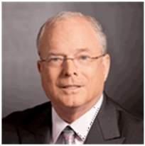 Gary B. Moore, Presidente y Director de Operaciones