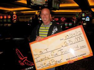 Scott, from Elk Grove, Calif., celebrates a $25,000 Three Card Poker Bad Beat jackpot at Red Hawk Casino.