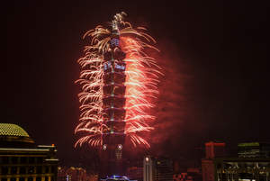 Colorful fireworks launched from TAIPEI 101 illuminate the sky of Taipei as the New Year begins.