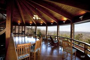 The estate's family room and dining room feature floor-to-ceiling windows to take in the views. The auction will take place on February 26