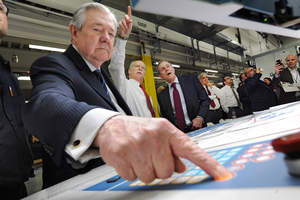 Frank A. Bennack, Jr., chief executive officer of Hearst Corporation, presses the button for the inaugural press run of the new press at the Albany Times Union on Thursday, March 14, 2013 in Colonie, N.Y.