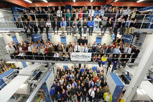 Times Union employees stand in front of the new press at the Times Union on Tuesday, March 5, 2013 in Colonie, N.Y.
