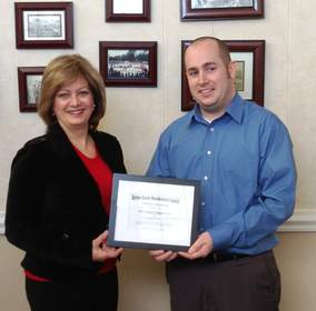 Cheryl Miller, president and CEO of New Products Corporation, receives the Berrien County Manufacturers Council Appreciation Award from Joe Sobieralski, executive director of the Southwestern Michigan Economic Growth Alliance.