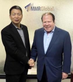 Unis-Tonghe Chairman Luo Jianhui and MMRGlobal Chairman/CEO Bob Lorsch at  MMR's Los Angeles Headquarters on 4-29-2013.