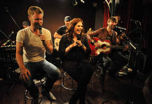 Charles Kelley, Hillary Scott and Dave Haywood  perform during Lady Antebellum's ''Golden'' Release Show Presented By Citi At The McKittrick Hotel, Home of Sleep No More on May 7, 2013 in New York City.  (Photo by Kevin Mazur/WireImage)