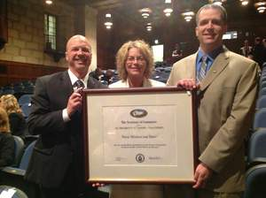 From left: Hurd President/CEO Dominic Truniger, Hurd Director of Marketing April Lucas and Hurd Director of International Sales Scott Klieforth accept the President's 'E' Award for Exports.