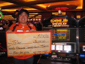 Tyler from Va., celebrates a $20,074 slot jackpot at Red Hawk Casino.