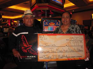 James, from Cypress, Calif., celebrates a $39,999 slot jackpot at Red Hawk Casino.