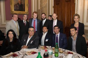 Congressman Joe Kennedy posing Rabbi Elie Abadie and founding members of the Safra Synagogue