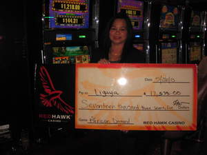 Ligaya, from Pacifica, Calif., celebrates a $17,375 slot jackpot at Red Hawk Casino.