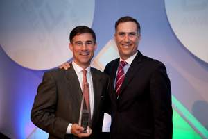 Tony Abate accepts Emerging CFO of the Year Award with Echo360 CEO Fred Singer.