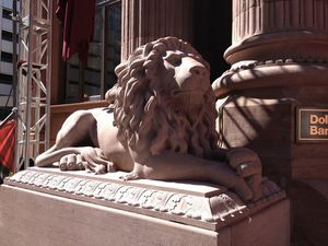 A close up of the lion to the left of the entrance.