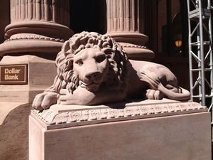 A close up of the lion to the right of the entrance.