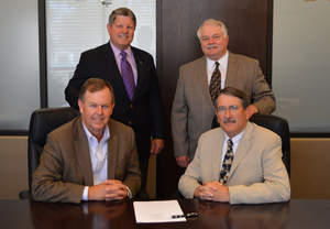 Two community banks, Texas Regional Bank and Border Capital Bank sign merger.
