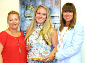 Pictured left to right are Sandy Huseby, CACM 'Rookie of the Year' winner Courtney Chastain, and Margo Crummack