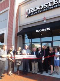 Participating in the store opening of Roosters Men's Grooming Center in MarketStreet Lynnfield are representatives of the Wakefield Chamber of Commerce and Roosters MGC team members