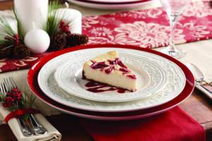 Vanilla-Orange Cheesecake with Cranberry Swirl & Gingersnap Crust