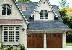 Rhapsody carriage style garage doors from Artisan Custom Doorworks