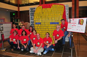"Newforma employees with their entry, ""Iron Can,"" in this year's Canstruction® Boston design/build competition."