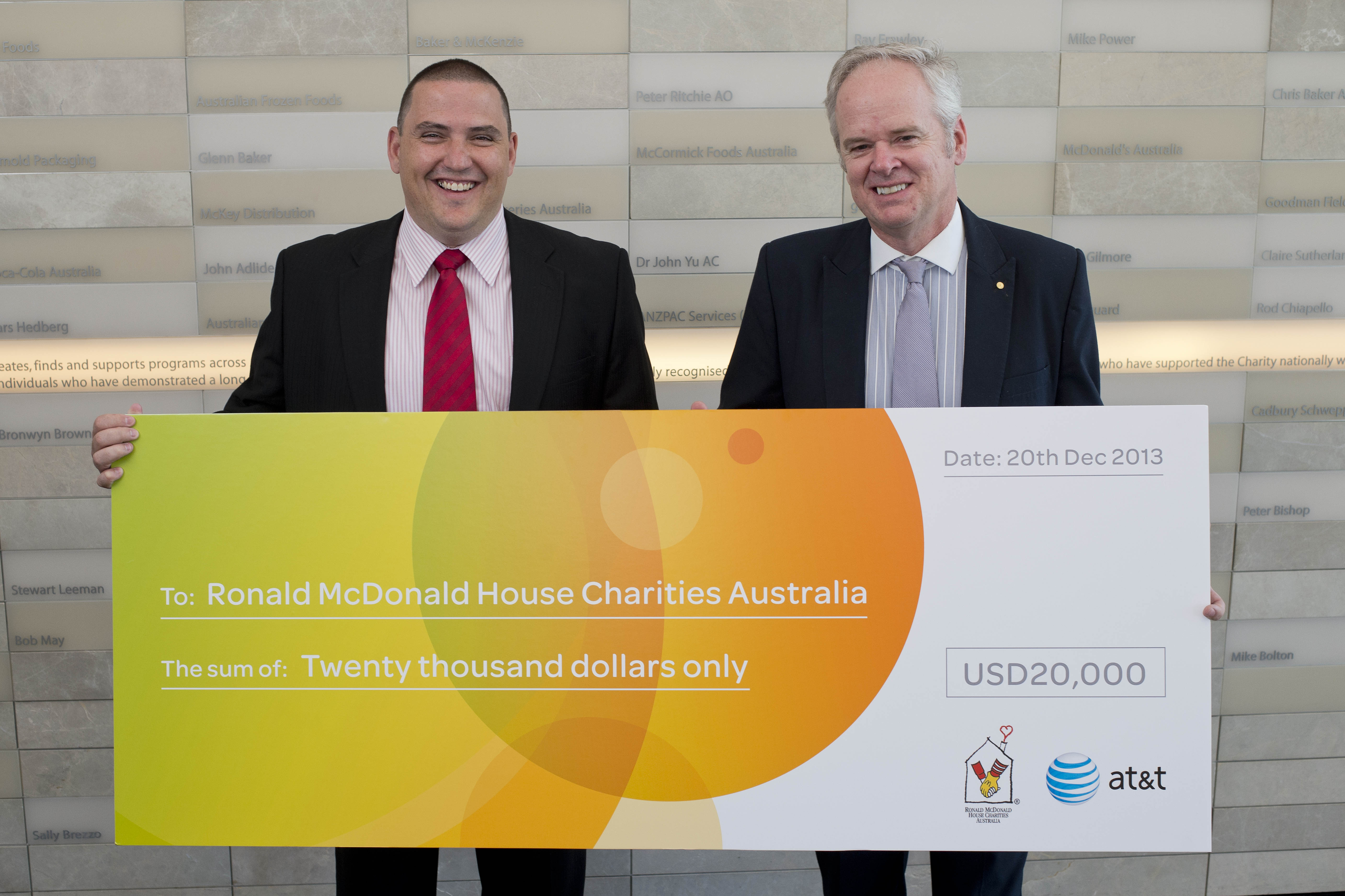 Ronald McDonald House Charities Australia (right) receives $20,000 donation from AT&T.