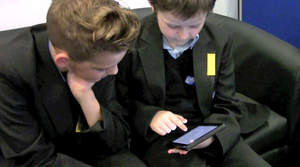 Two boys using an iPad