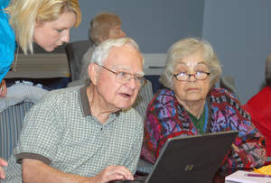 Maple Knoll Village residents with laptop.