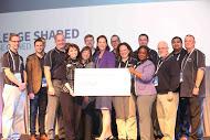 Harte Hanks team presenting $60,000 in marketing services to eight Orlando area non-profit organizations