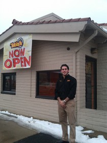 Shaun Marogi, owner of three Tubby's Sub Shops, stands outside his store in Berkley, Michigan