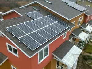 Above view of rooftop solar installations at Great Oak Cohousing