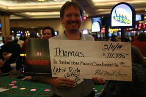 Thomas, from Sacramento, Calif., celebrates a $111,705 Let It Ride progressive jackpot at Red Hawk Casino.