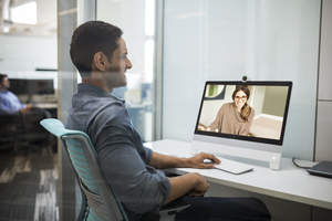 Cisco's new DX80 has a larger (23-inch) screen and comes equipped with the new Intelligent Audio feature. This feature would ensure that the colleague on the screen would not hear noise from the meeting going on in the background of this shot -- even if that meeting got very loud.