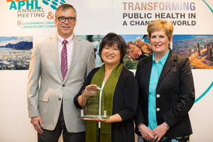 Dr. May Chu (center) with APHL president, Dan Rice (left), and past president, Christine Bean (right
