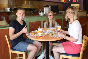"""Ryan Semanco, 15, gives a """"thumbs up"""" to the gluten-free sub he enjoyed at Tubby's Sub Shops in Shelby Township, Mich., with his sister Jillian, 12, and mom Shelly Semanco."""