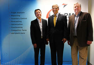 Revenue Management Systems' Lawrence Siao, Vice President of Marketing – Asia (Left) and Scott Schade, CEO (Right) stand with Washington Governor Jay Inslee (Center) at their Seattle, Washington Headquarters